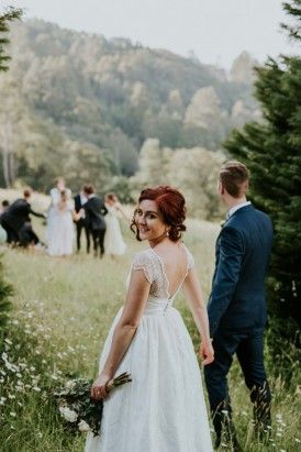 There is no need to host an evening wedding when planning a forest wedding and there will be less bug spray to worry about! Photo by Daniel Milligan.