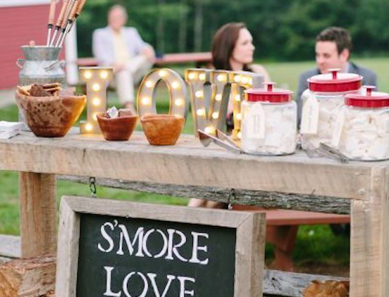 Interactivity is a must at weddings. Why not let your guests pack a few S'mores just they way they like them? Wedding photography: Stacey Hedman.