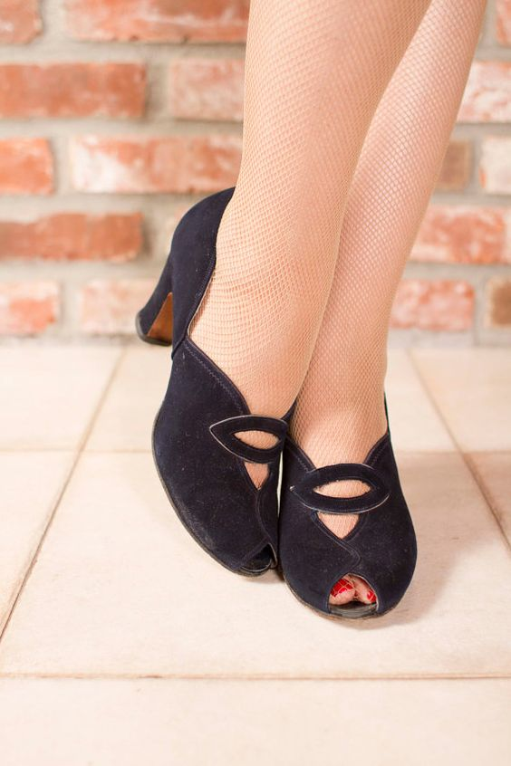 These 1940s iconic and adorable navy blue suede heel pumps are a classic and will match a vintage theme to perfection.