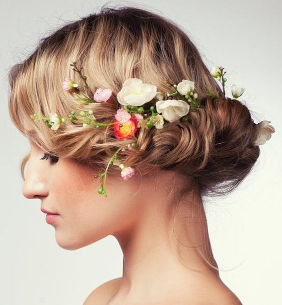 We've spent hours scouring the Internet in search for the top 2017 trending wedding hairstyles. Here's one! A low updo with floral crowns.