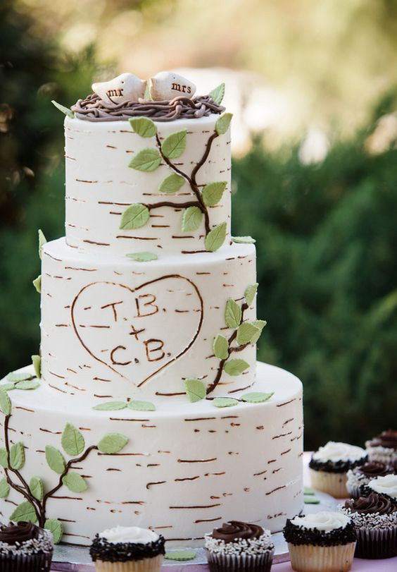 This wedding cake screams enchanted forest wedding! Birch-inspired wedding cake with the cutest cake topper!