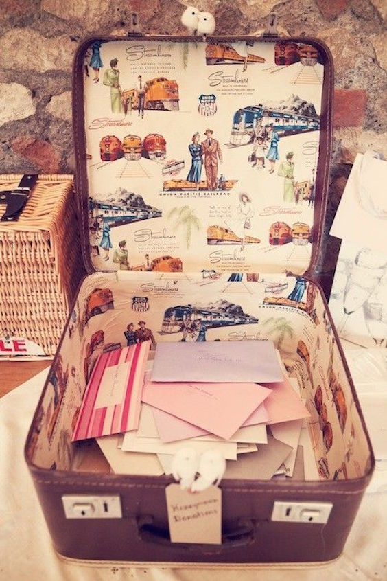 Bring out the antiques and collect wedding cards. A conversational piece and more innovative than a giant box wrapped in the wedding colors.