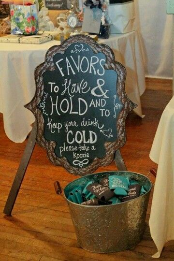 Funny wedding sign to point to your basket of goodies... errr... koozies! To have and to hold and to keep your drink cold. Wedding photographer: Kelly Beane Photography.
