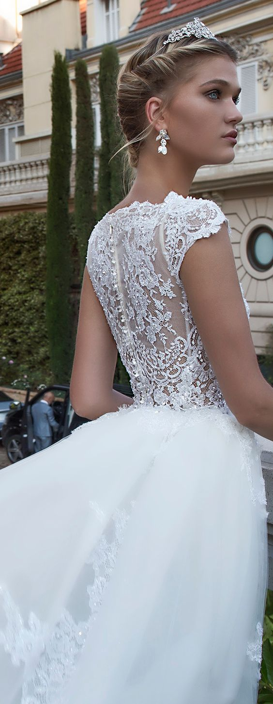 Adorable white wedding gown by the Italian designer with cap sleeces and embroidery all over. Bibi. Alessandra Rinaudo 2017 Collection wedding dresses.