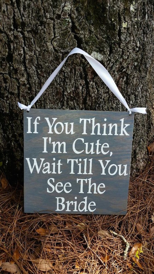 These wood signs are such a cute way to have your ring bearers or flower girls enter and/or exit your wedding ceremony.