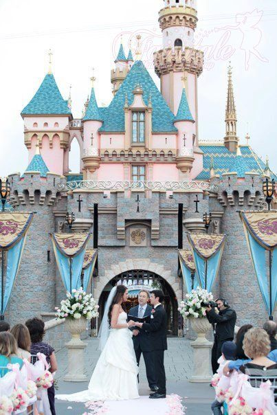 Disneyland Sleeping Beauty Castle wedding. Who wouldn't love a Disney reception?
