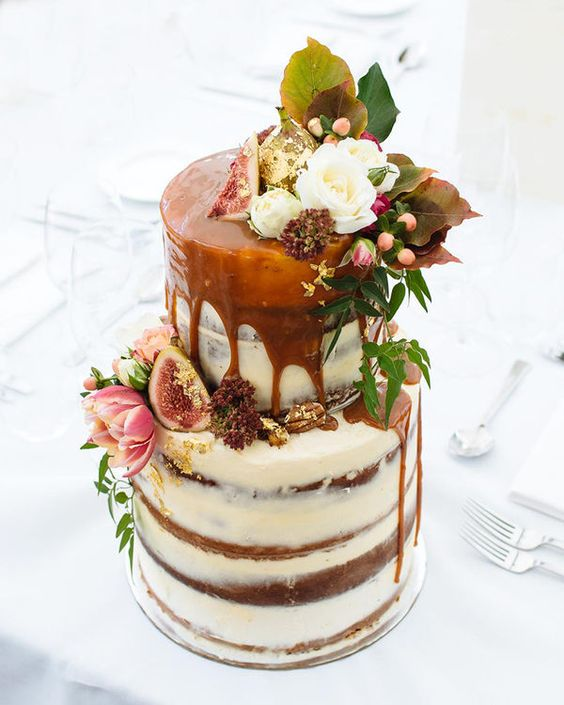 Fall wedding cake flavors. Gone are the light flavors of citrus and summer fruits. Autumn events favor decadently rich desserts, such as this wedding cake drizzled with salted caramel and decorated with figs.