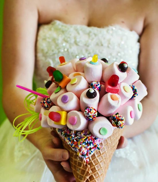 Fun and funky wedding bouquets for the non-traditional bride. Candy bouquet of marshmallows and candy in cone. I don't think it will make it to the wedding day!