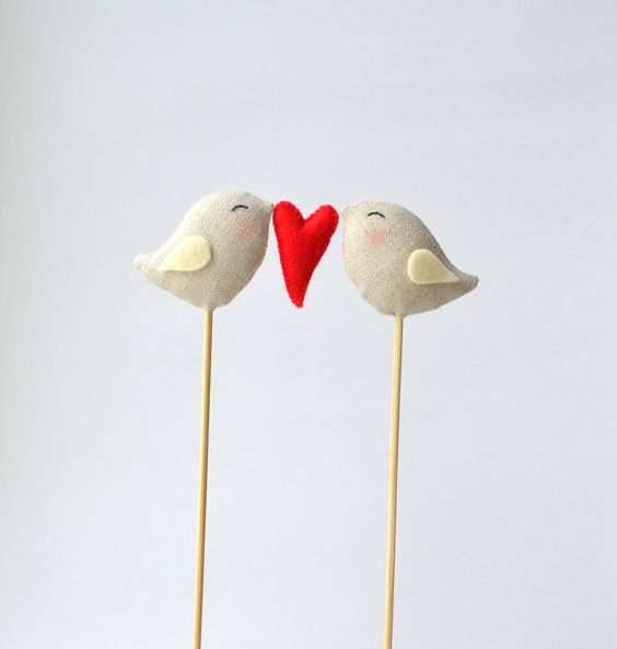 This pretty topper is simple yet oh-so-adorable. Love birds wedding cake topper.