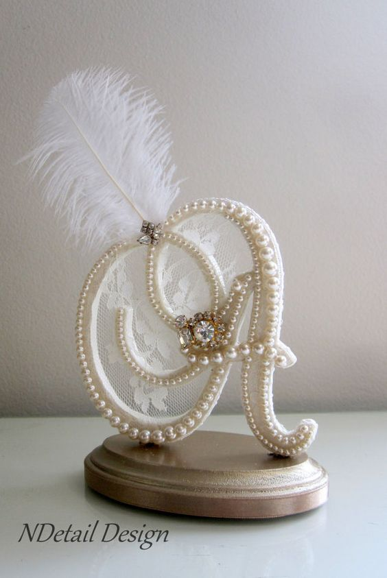 Don't forget the wedding cake topper! This custom monogram A vintage in ivory with pearls, lace & ostrich feather with gold jewelry is ideal for a Gatsby wedding cake.