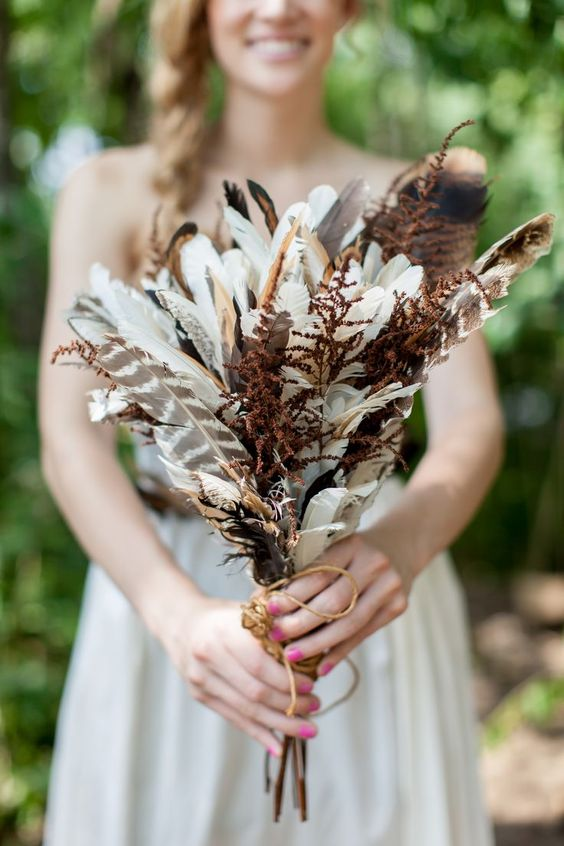 Absolutely stunning bride's bouquet with feathers.