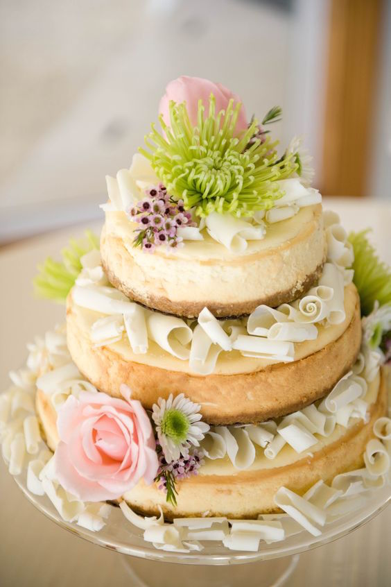 An alternative to the traditional wedding cake! Delicious cheesecake with white chocolate swirls. Made by Alyeen Wakefield.
