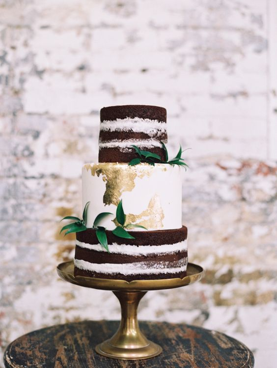 Three tier chocolate and vanilla edible gold wedding cake. Wedding photographer: Diana McGregor.