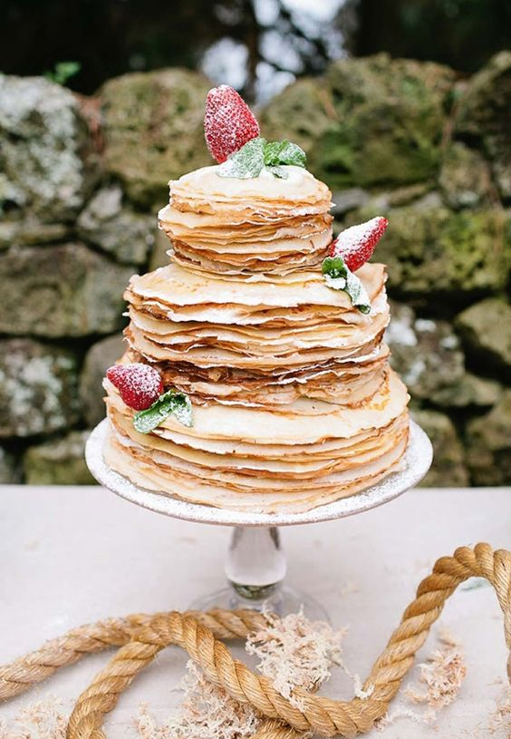 Pick a non-traditional cake for your wedding like a crepe wedding cake. We love alternative wedding cake flavors!