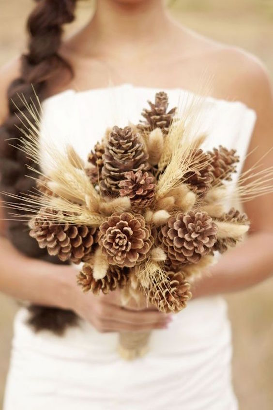 Pinecones and wheat make for an original and unique non-floral winter wedding bouquet. A gorgeous alternative for the eco-conscious bride.