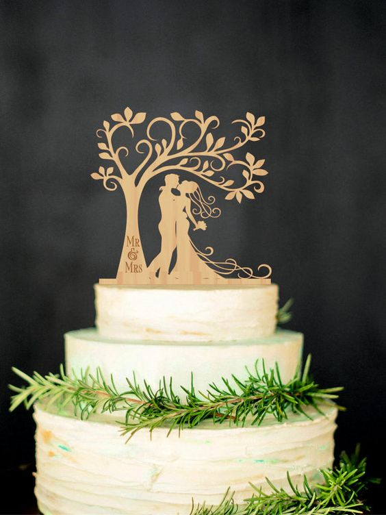 Bride and groom carved wood cake topper will bring you an opportunity to personalize your wedding cake and will help make it unique.
