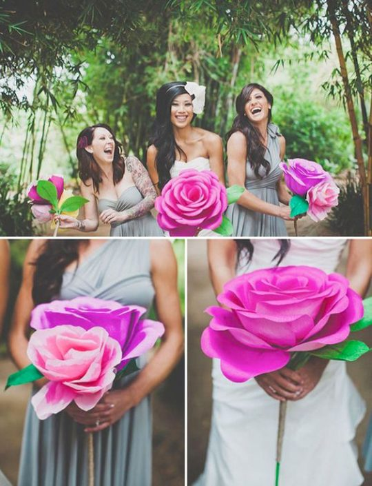 If you cannot part with the idea of a flowers but still want to save some money, check out this impossibly fun wedding idea. Bright pink paper flower bouquets.