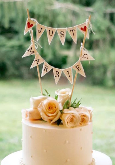 Tiny banners with twine are a great choice for rustic weddings. Photographer: 52Forty Photography Cake by Jeffery A. Miller Catering.