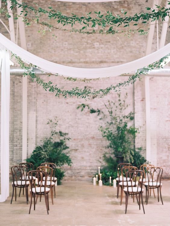 Modern and trendy wedding at the HNYPT LA. Greenery, candles and a few simple chairs. Photography: Diana McGregor.