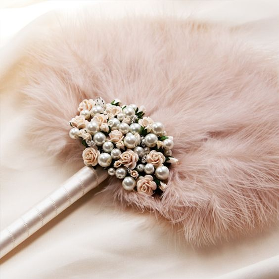 Pink feather fan for a Gatsby wedding. Totally unconventional bridal bouquet.