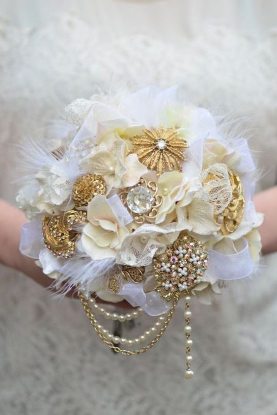 Gorgeous and unique wedding bouquet ideas. White and gold alternative bridal bouquet that lasts forever!
