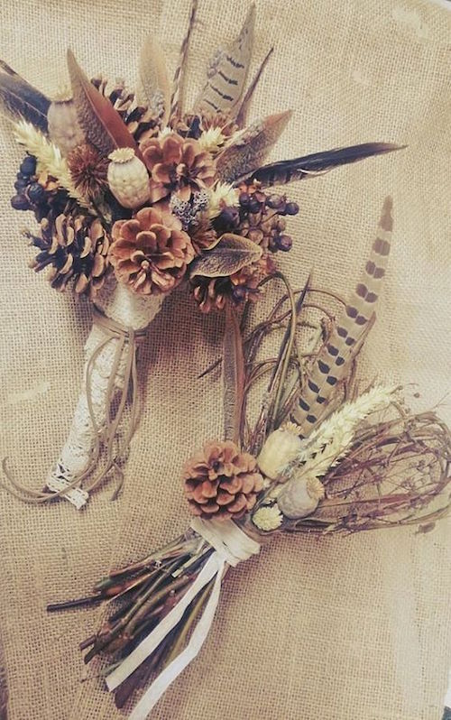 Woodland weddings deserve this unique wild feather and pine cone bouquet. Isn't it gorgeous?