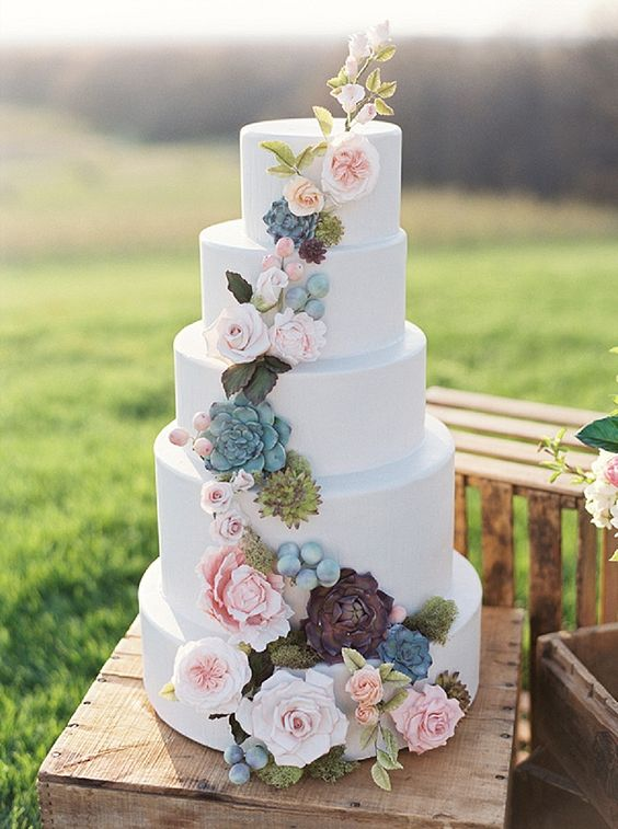 Bohemian style wedding cake with succulents and flowers.