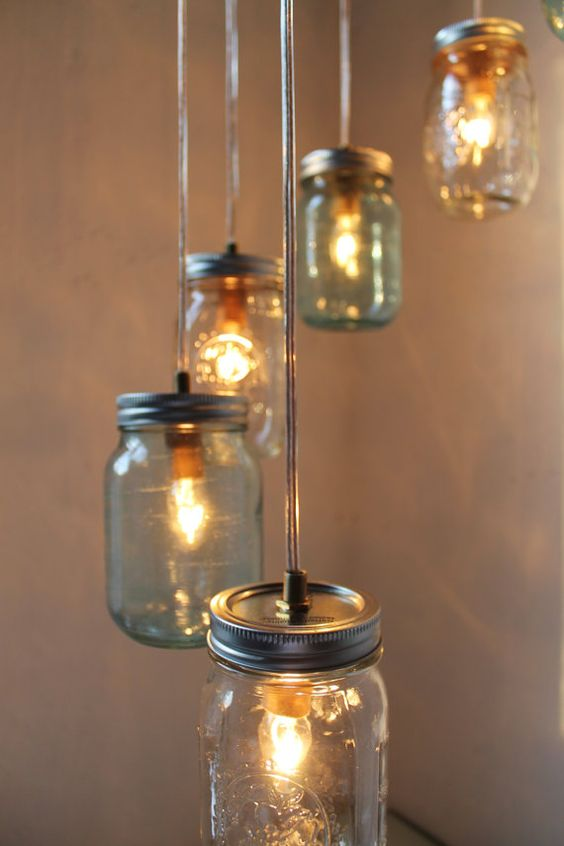 Fun idea for a patio wedding? Mason jar chandelier hanging centerpiece swag by BootsNGus.