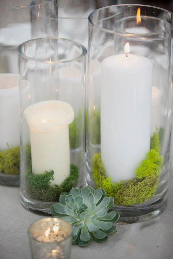 Candles and moss is all you need to make these adorable lighted centerpieces for wedding receptions.