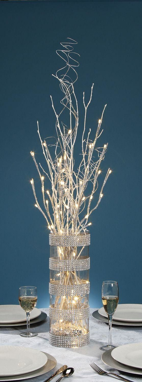 Cool and affordable lighted centerpieces for wedding receptions. The step by step on the blog!