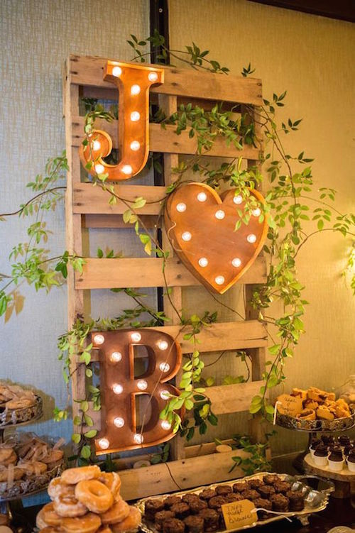 Marquee monogram for the dessert table at a backyard wedding venue.