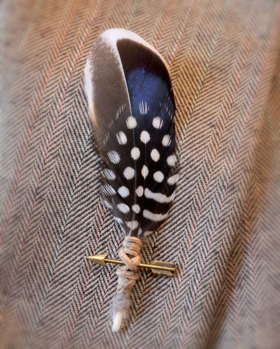 This handsome boho boutonniere features neutral feathers, a bronze-tone arrow, and a rustic twine wrap. So handsome, and loaded with bohemian charm.