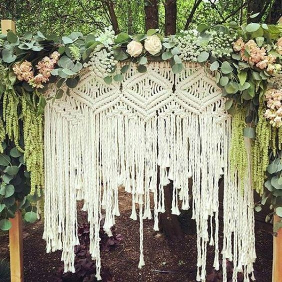 Do you macrame? Lovely and very boho ceremony backdrop. Macrame is a unique and beautiful knotted piece of art that looks amazing hanging inside of an indoor or outdoor venue.