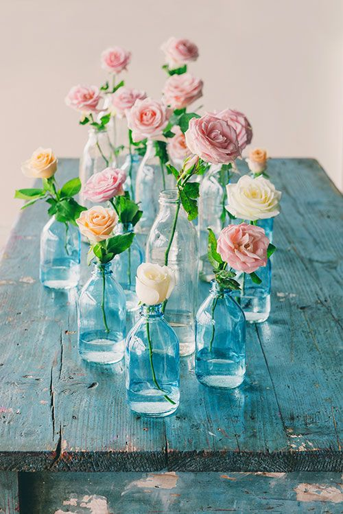 Adorable centerpieces in blue for a boho wedding.