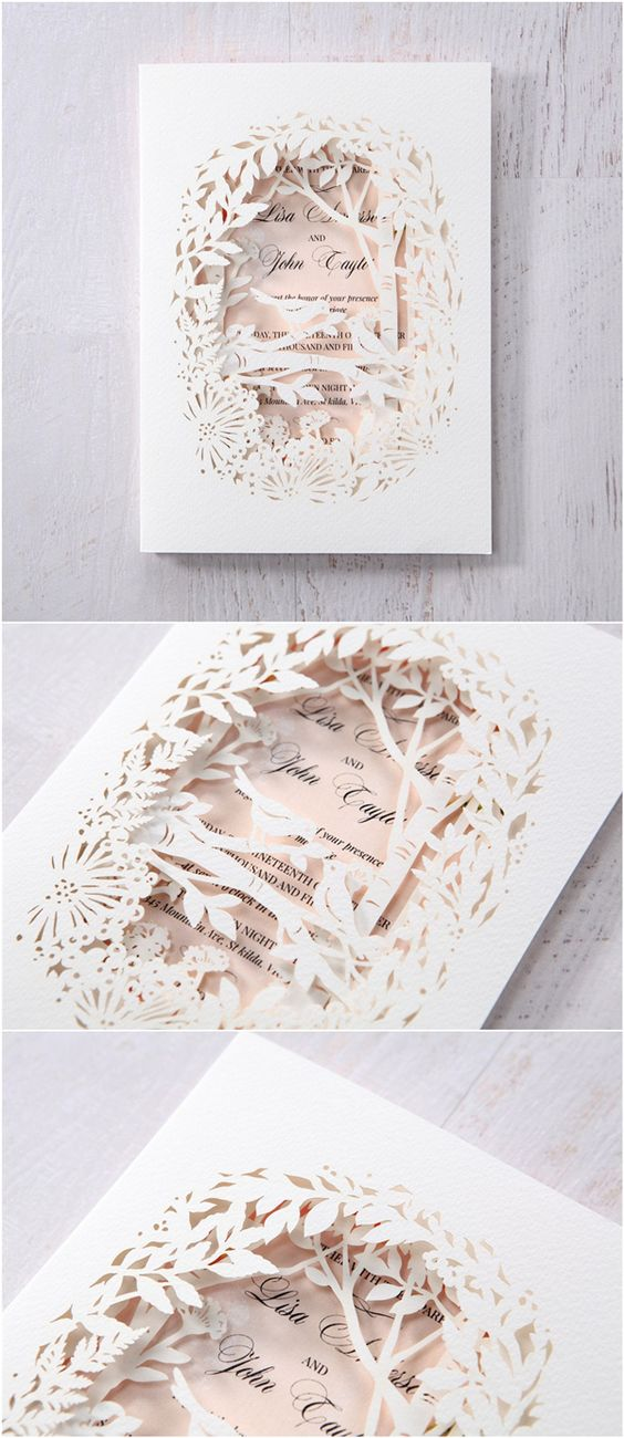 Elegant blush and white laser cut wedding invitations.
