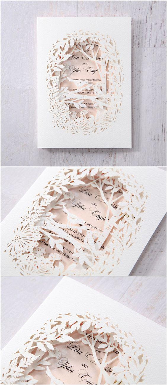 Elegant blush and white laser cut wedding invitations.