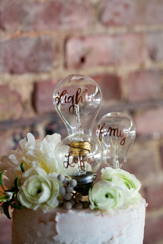 Industrial wedding inspiration with a neo-vintage twist light bulb cake topper. Wedding photographer: Mirabel Photography.