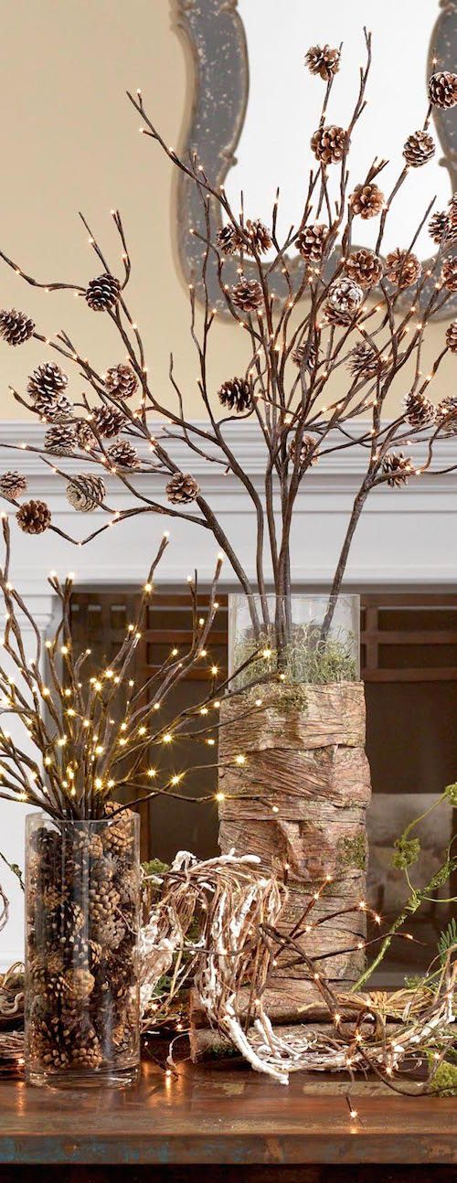 Clear vases, lighted branches and pine cones... sounds simple enough. ;)