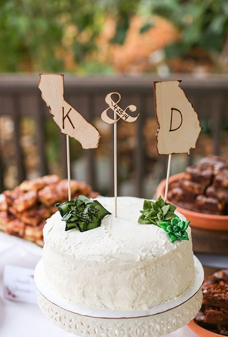 Rustic State monogram cake toppers with the bride and groom's initials.