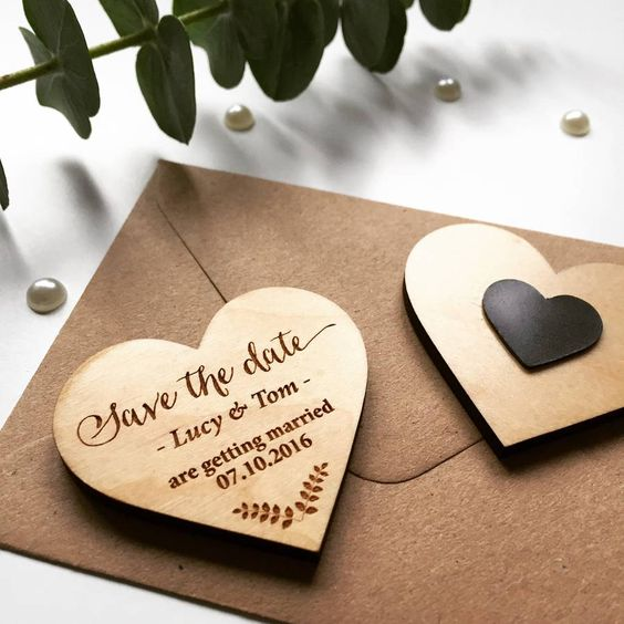 Delicate and romantic laurel wooden magnet Save The Date.