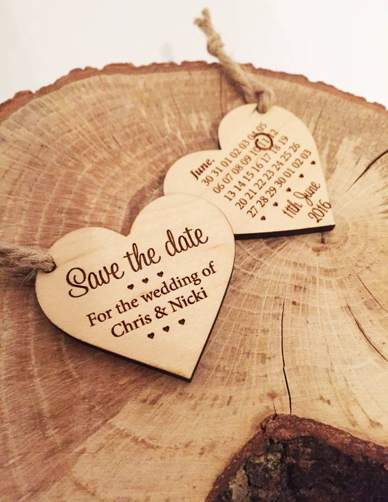 Take advantage of both sides of the save the date with a wooden heart tied to a string! By bateman designs.