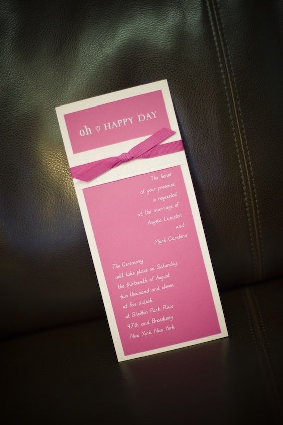 Adorable wedding invitations in fuchsia with a bow.
