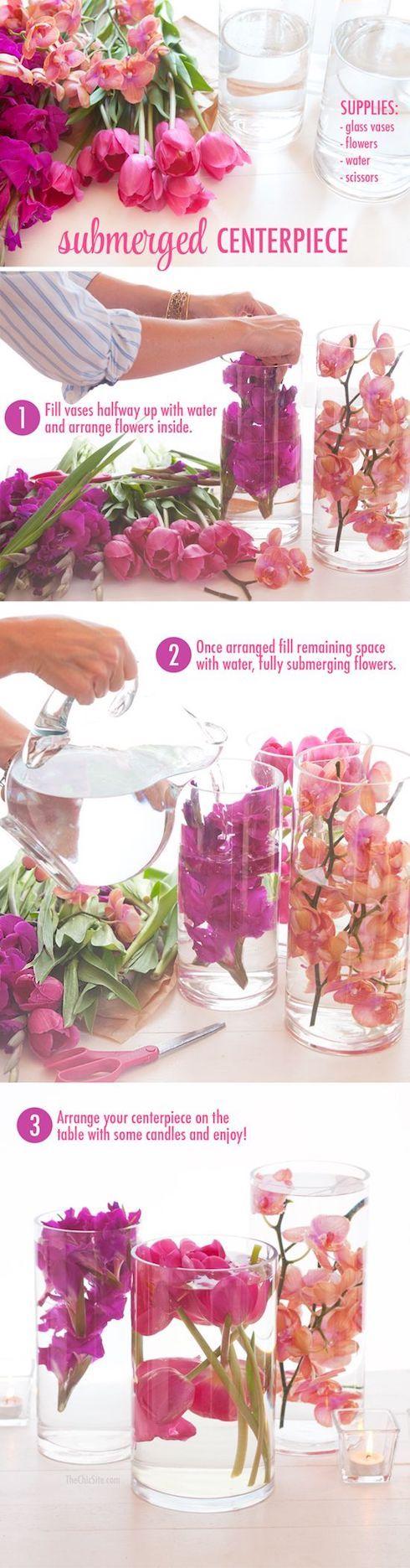 Centros de mesa con flores sumergidas.