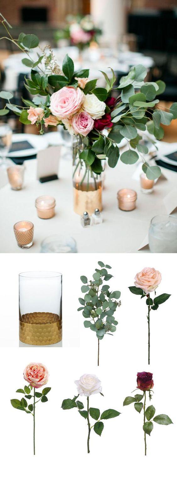 Eucaliptos, rosas y ranúnculos en centros de mesa románticos.