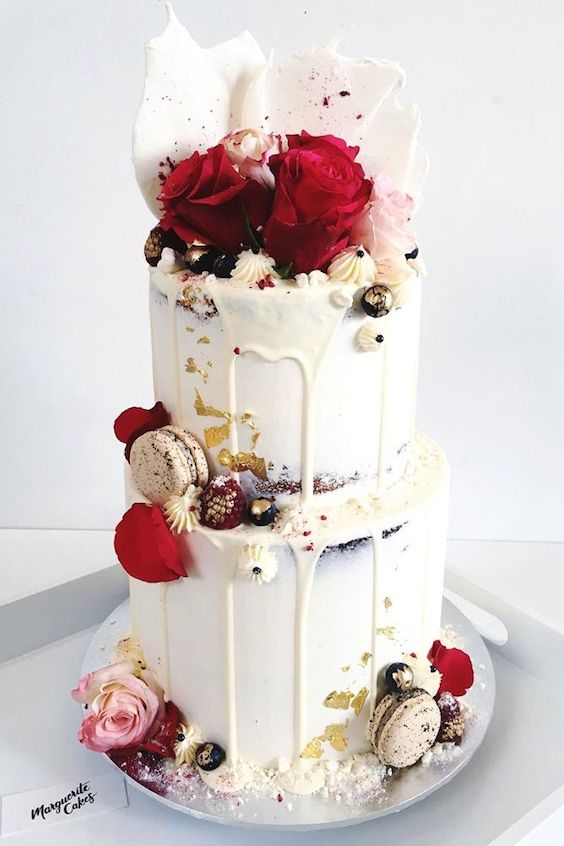 White chocolate ganache drip cake with macarons.