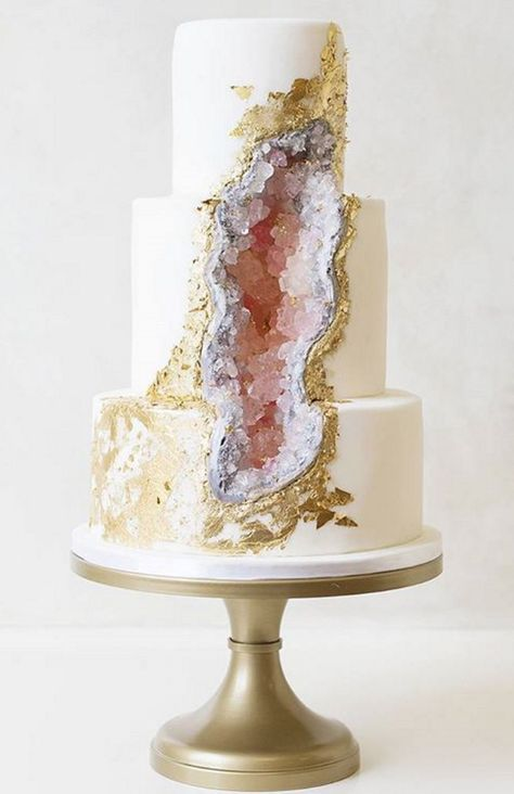Stunning cake reveals an edible Amethyst Geode beneath Its surface. The gold leaf decor makes it stand out even more.