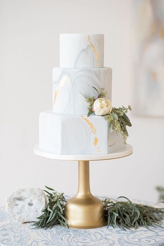 Beautiful dove grey marbled wedding cake with gold leaf details.