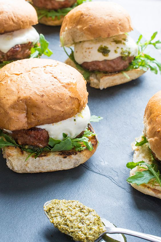 These mouth-watering grilled turkey burgers are topped with fresh pesto, spicy arugula and creamy mozzarella cheese.
