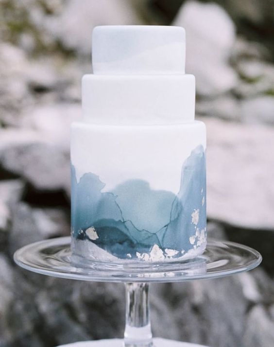 The minimalist blue icy detail of this hand painted winter wedding watercolor cake sets it off.