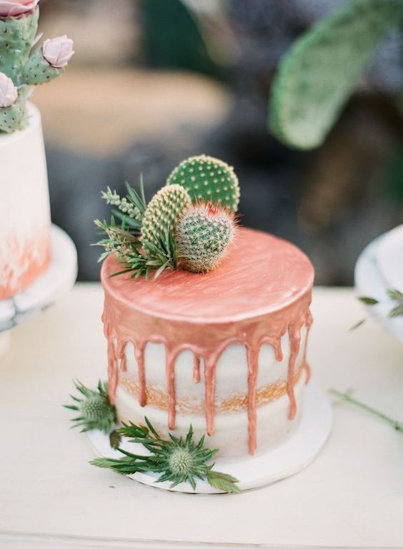 Two of the latest wedding cake trends: Metallic pink drip cake with a cactus topper for an intimate Boho wedding.